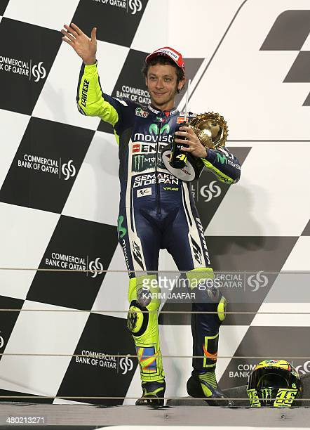 Italian MotoGP rider Valentino Rossi of the Movistar Yamaha MotoGP team celebrates on the podium after finishing second in the MotoGP race of the...
