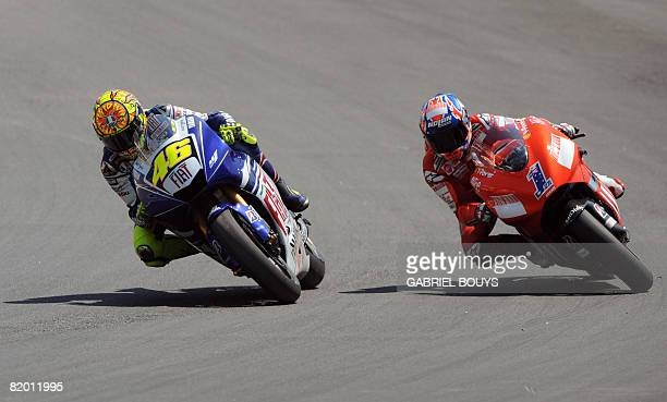 Italian MotoGP rider Valentino Rossi on his Fiat Yamaha leads in front of Australian Casey Stoner on his Ducati during the Red Bull US Grand Prix in...