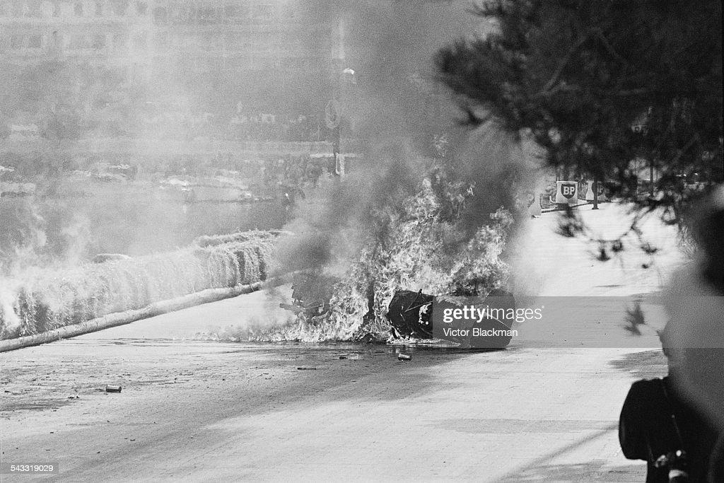 Italian motor racing driver Lorenzo Bandini's Ferrari in flames after crashing during the Monaco Grand Prix, 7th May 1967.