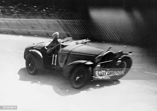 Italian motorcycle and automobile racing driver Tazio Giorgio Nuvolari as the winner in the 24-hour Le Mans race on the track. 19th June 1933....