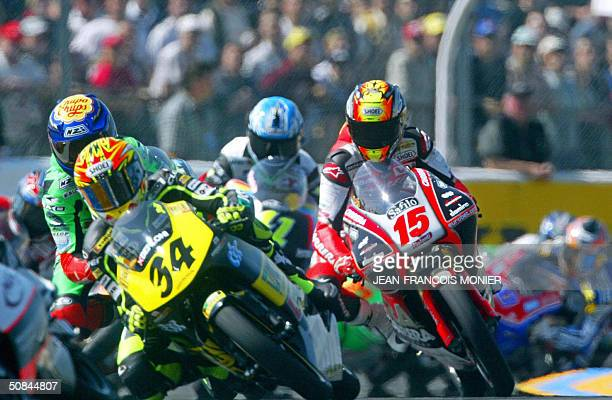 Italian motorcyclists Andrea Dovizioso and Roberto Locatelli rides during the 125cc category of the French motorcycling Grand Prix the third round of...