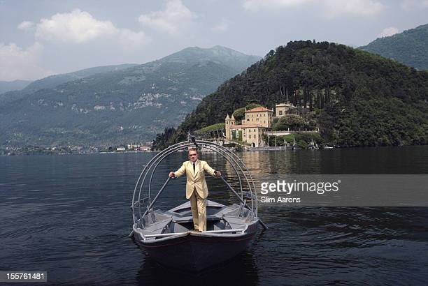 Italian mountain climber and explorer Count Guido Monzino rowing on the waters of Lake Como towards his home, Villa del Balbianello, Lenno, Italy, in...