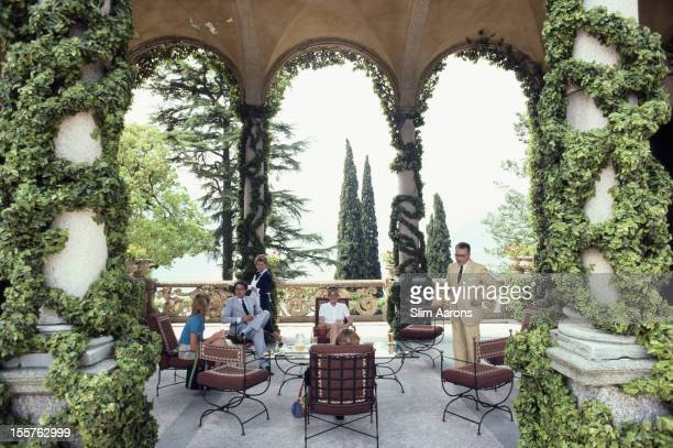 Italian mountain climber and explorer Guido Monzino and four people relaxing on the terrace of Monzino's home, Villa del Balbianello in Lenno,...