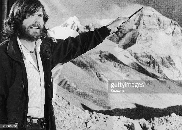 Italian mountaineer Reinhold Messner points to a photograph of Mount Everest after his unprecedented solo ascent without supplementary oxygen 1980