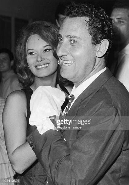 Italian movie actor Alberto SORDI dances with young actress Lea MASSARI in a night club. Alberto SORDI is starring in Viareggio in the film A...