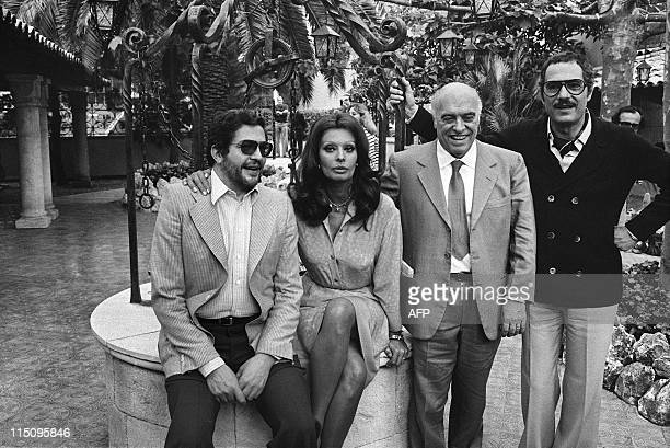 Italian movies maker Ettore Scola sits beside Italian actress Sophia Loren, her husband Italian producer Carlo Ponti , and Italian actor Nino...
