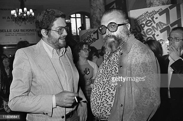 Italian movies makers, Ettore Scola and Sergio Leone, speak on May 20, 1977 during the 30th International Fillm Festival in Cannes. AFP PHOTO PATRICK...