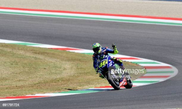Italian Movistar Yamaha rider Valentino Rossi celebrates after the free practice session of the Moto GP Italian Grand Prix at Mugello racetrack on...