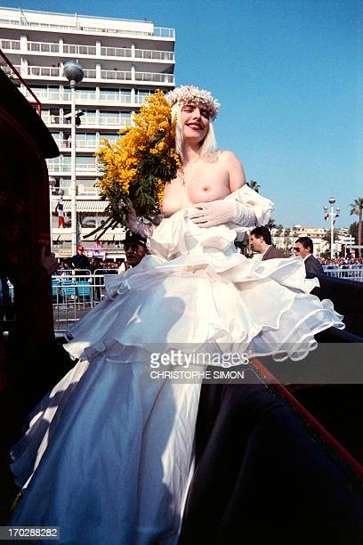 Italian MP Ilona Staller known as Cicciolina appears barebreasted at the Nice Carnaval southern France on February 20 1988 AFP PHOTO CHRISTOPHE SIMON
