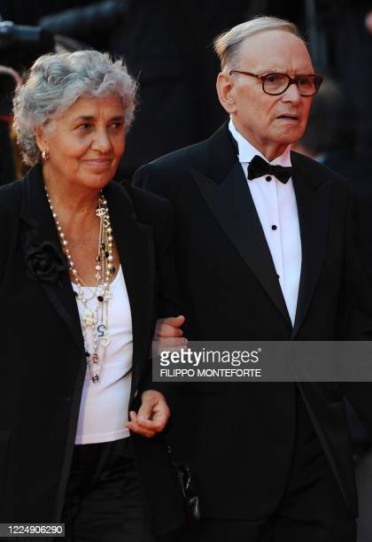 """Italian music composer Ennio Morricone and his wife arrive for the screening of """"Baaria"""" at the Venice film festival on September 2, 2009. Baaria by..."""