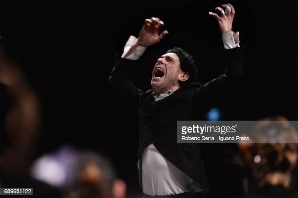 Italian musician and composer Ezio Bosso conducts the Orchestra and the Choir of the Bologna's Teatro Comunale in concert for charity for the victims...