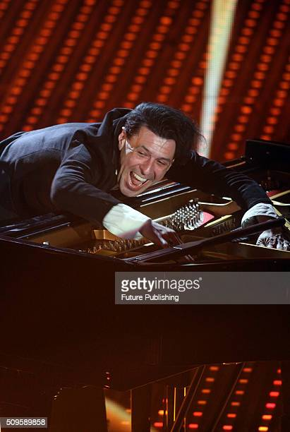 Italian musician Ezio Bosso performs on stage during the Sanremo Italian Song Festival at the Ariston theater on February 10 2016 in Sanremo Italy...
