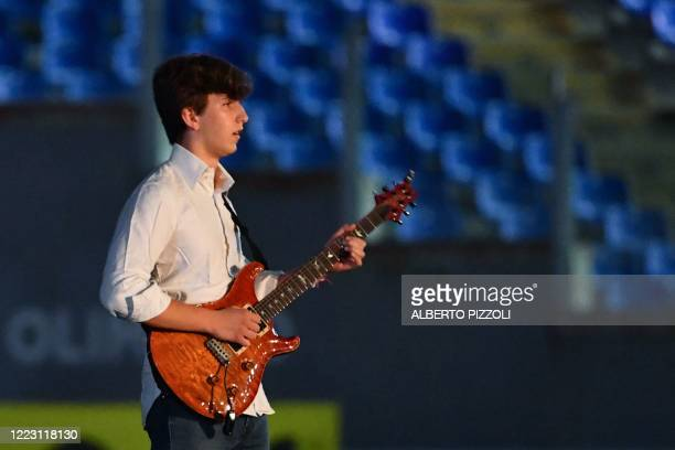 Italian musician Jacopo Mastrangelo plays guitar prior to the Italian Serie A football match Lazio vs Fiorentina played on June 27 2020 behind closed...