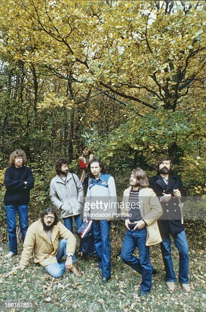 Italian musician singersongwriter and writer Francesco Guccini posing with the Italian band Nomadi The band is formed by Italian keyboard player...