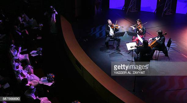 Italian musicians perform the String Quartet in E minor by Giuseppe Verdi on August 8 2016 during the opening ceremony of the Summer Cultural...
