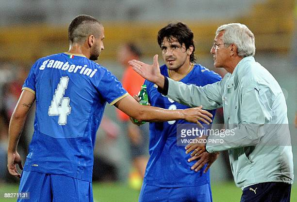 Italian national football team's coach Marcello Lippi directs Italian defender Alessandro Gamberini and Italian midfielder Gennaro Gattuso during...
