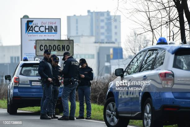 Italian National Police officers patrol on February 23, 2020 at the entrance of the small Italian town of Codogno, under the shadow of a new...
