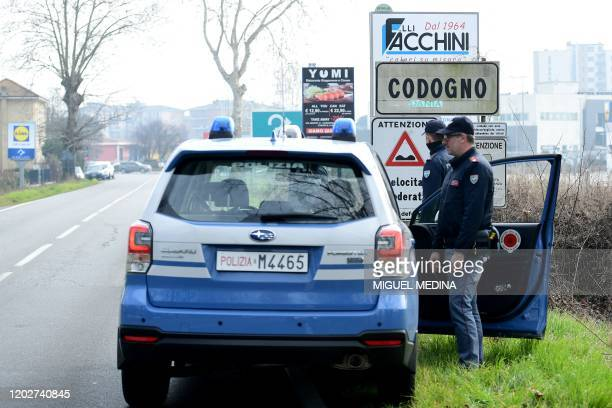 Italian National Police officers patrol on February 23 2020 at the entrance of the small Italian town of Codogno under the shadow of a new...