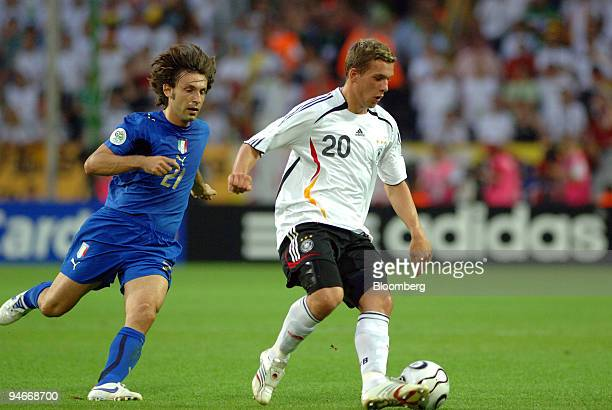 Italian national team player Andrea Pirlo chases after German national player Lukas Podolski during the Germany versus Italy 2006 FIFA World Cup...