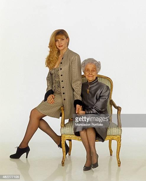 Italian neurologist and senator for life Rita Levi Montalcini sitting on an armchair beside Italian TV presenter and dancer Lorella Cuccarini She's...