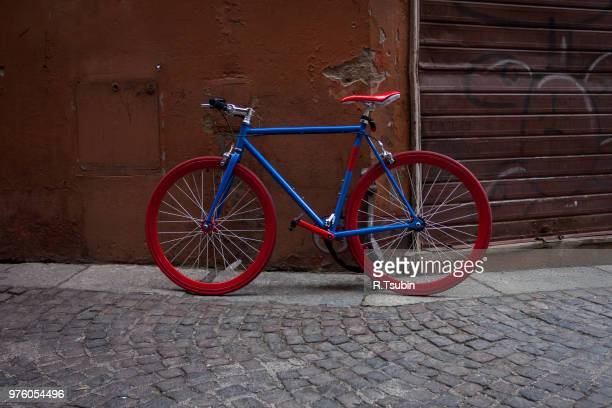 Italian old-style bicycles leaning against a wall in the historic center of Bologna