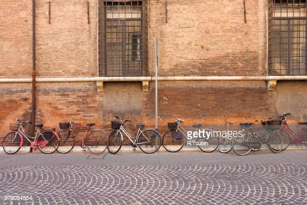 Italian old-style bicycles leaning against a wall in the historic center