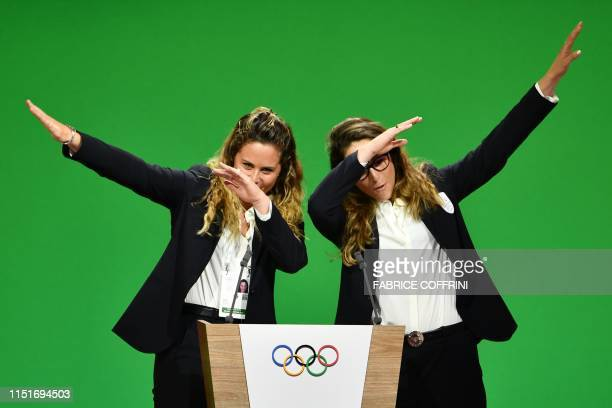 Italian Olympic champions Michela Moioli and Sofia Goggia gestures on stage during the Milan/Cortina d'Ampezzo candidature committee's final...