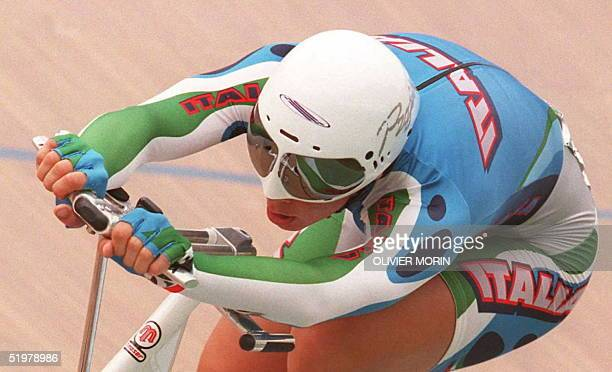 Italian Olympic team cyclist Antonella Bellutti performs during the women's individual pursuit semifinals at the Stone Mountain Olympic track in...