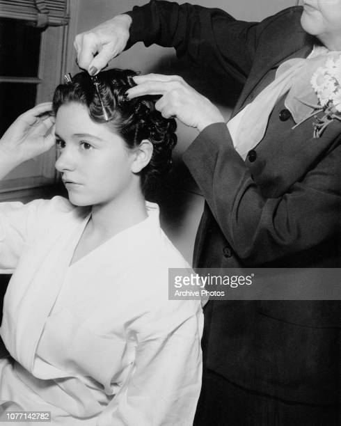 Italian opera singer and actress Anna Maria Alberghetti has her hair done by stylist Nellie Manley on the set of the Jerry Lewis film 'Cinderfella'...