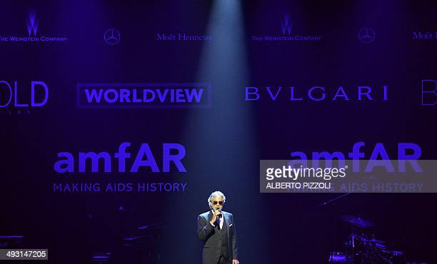 Italian opera singer Andrea Bocelli performs during the amfAR 21st Annual Cinema Against AIDS during the 67th Cannes Film Festival at Hotel du...