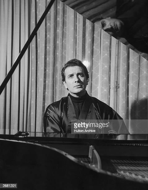 Italian opera singer Franco Corelli at the piano in his house in Milan rehearsing for the 'Compare Turiddu' in the production of Cavalleria Rusticana...