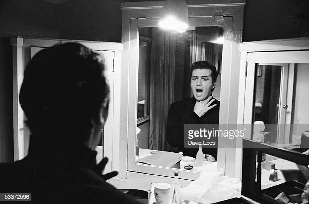 Italian opera star Franco Corelli warming up in his dressing at La Scala.