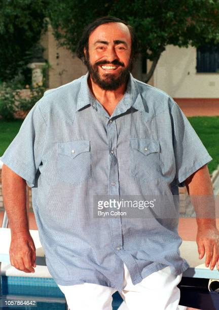 Italian Opera star, Luciano Pavarotti, recuperates by the swimming pool after undergoing major knee and hip surgery in July. Pavarotti spent time...