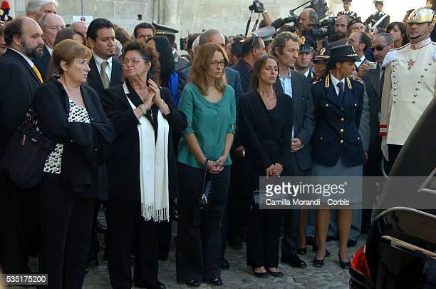 Italian opera tenor Luciano Pavarotti's sister Gabriella next to his widow Nicoletta Mantovani and his daughter Lorenza stand behind the hearse that...