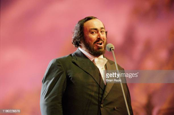 Italian operatic tenor Luciano Pavarotti performs live on stage during the Pavarotti and Friends for War Child benefit concert at Parco Novi Sad in...
