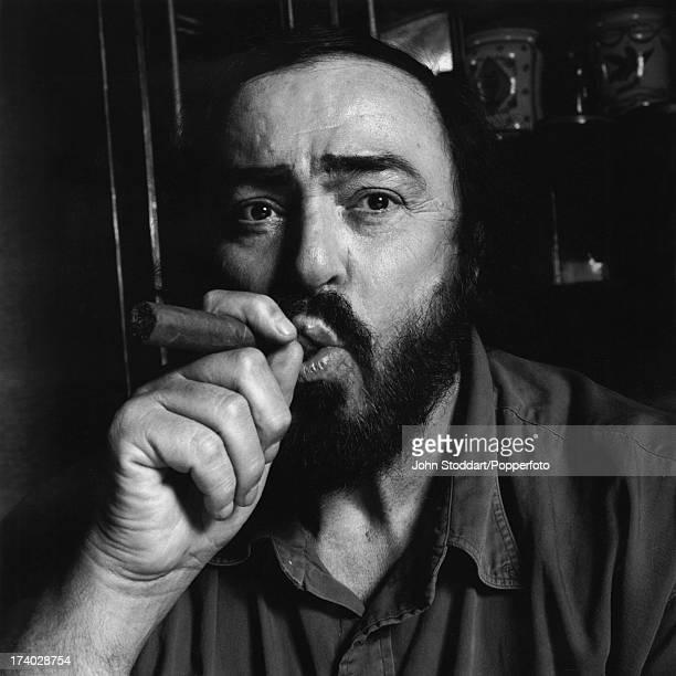 Italian operatic tenor Luciano Pavarotti , posed with a cigar in Naples, Italy in 1996.