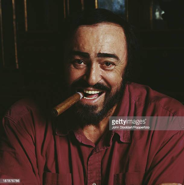 Italian operatic tenor Luciano Pavarotti smoking a cigar, 1996.