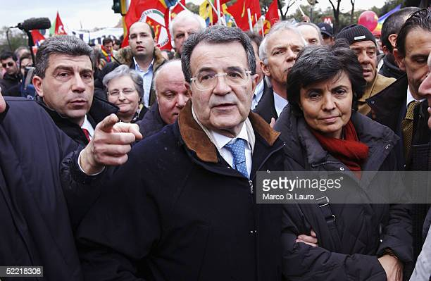 Italian opposition leader Romano Prodi and his wife attend a demonstration to show their support for the Italian journalist Giuliana Sgrenam during a...