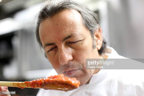 Italian oste e cuoco Filippo La Mantia smells his sugo at his eponymous restaurant in the Hotel Majestic on the Via Veneto on February 21 2011 in...