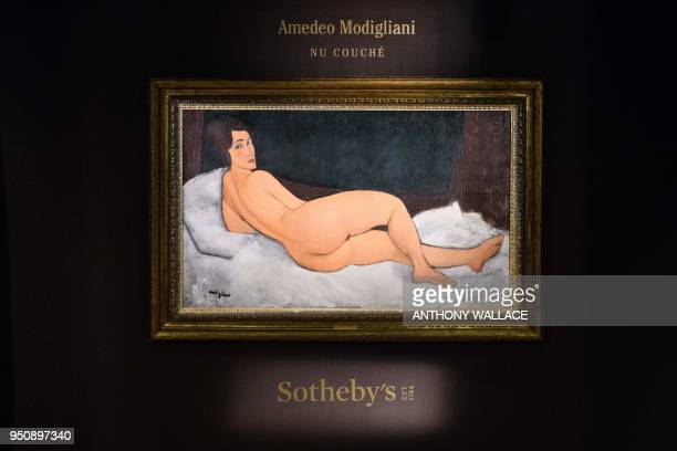 Italian painter and sculptor Amedeo Clemente Modigliani's 'Nu couché ' painting is displayed after its unveiling at the Sothebys auction house...