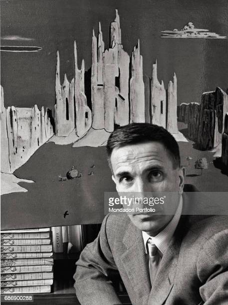 Italian painter and writer Dino Buzzati in front of one of his paintings This picture is taken from the monography Mario De Biasi Il mio sogno Š qui...