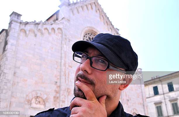 Italian painter Giuseppe Veneziano poses next to the Dome of Pietrasanta in Palazzo Panichi which is staging his latest major exhibition 'Zeitgeist'...