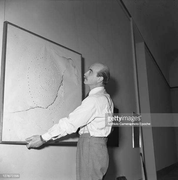 Italian painter Lucio Fontana during the Art Biennale Venice 1954