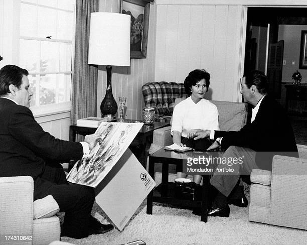 Italian painter Paulo Ghiglia portraying American actor Robert Taylor and his wife the German actress Ursula Thiess for the Hollywood Museum...