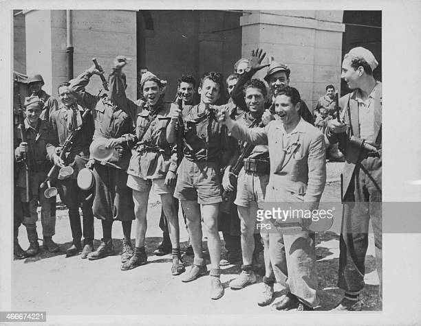 Italian partisans posing for the photographer, prior to their disarmament by the allies during World War Two, Milan, Italy, circa 1939-1945.
