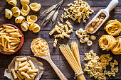 Italian pasta collection on rustic wooden table
