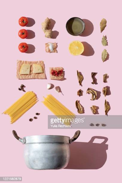 italian pasta ingredients on the pink background knolling - utensil stock pictures, royalty-free photos & images