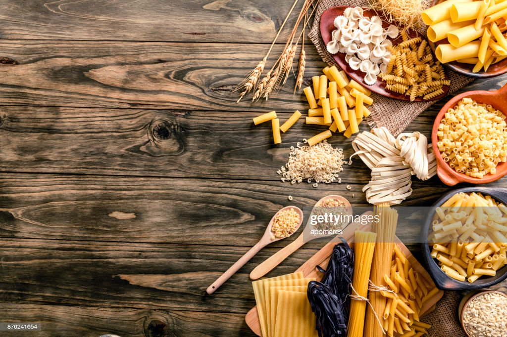 Italian pasta on rustic wooden table in a kitchen : Stock Photo