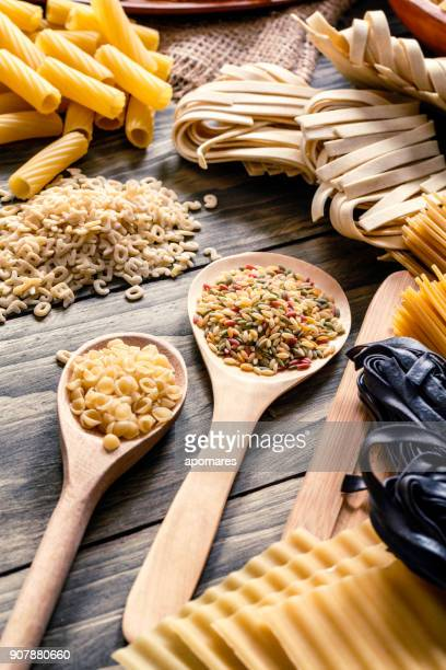 Italian pasta on rustic wooden table in a kitchen