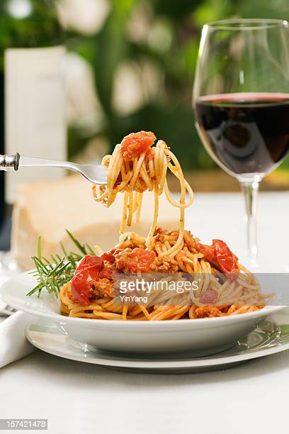 Italian Pasta Spaghetti Bolognese Dinner with Wine and Bottle